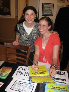 Chari Pere signs a copy of \